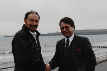 Ian Sutherland (left) with then-President Paul Leighton (right) in 1990
